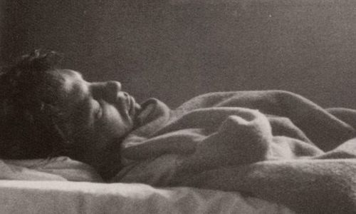 writer Jack Kerouac sleeping, 1958; photo by Robert Frank