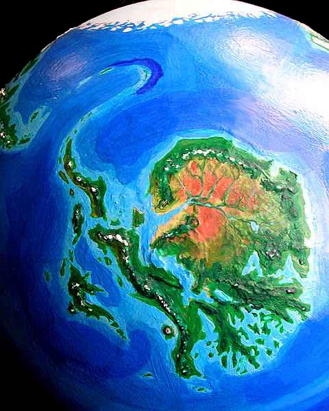 Orbital view of Seapole, a climatologically alternate Earth: Ornithia, the tropical landmass analogous to our Antarctica. Click to enlarge.
