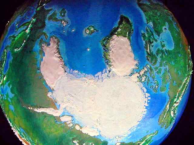 Orbital photo of Turnovia, an upside-down  Earth: the South Pole, showing the twin icecaps of Scandinavia and Greenland.