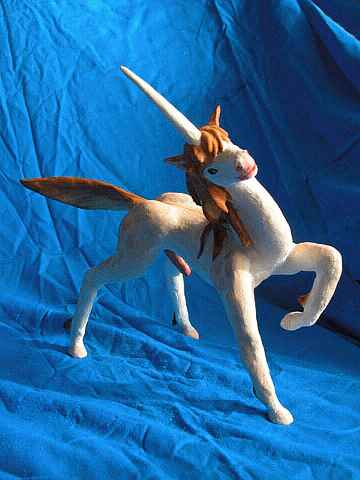 A randy unicorn stallion pawing and tilting his head: painted sculptures. Click to enlarge.