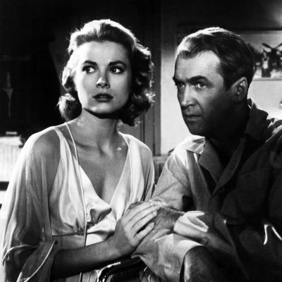 Grace Kelly and Jimmy Stewart in Hitchcock's REAR WINDOW.